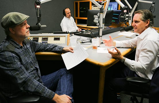 Behind the scenes of Money Unleased, financial advisor Chris Hoffman discusses the retirement radio show with a producer.